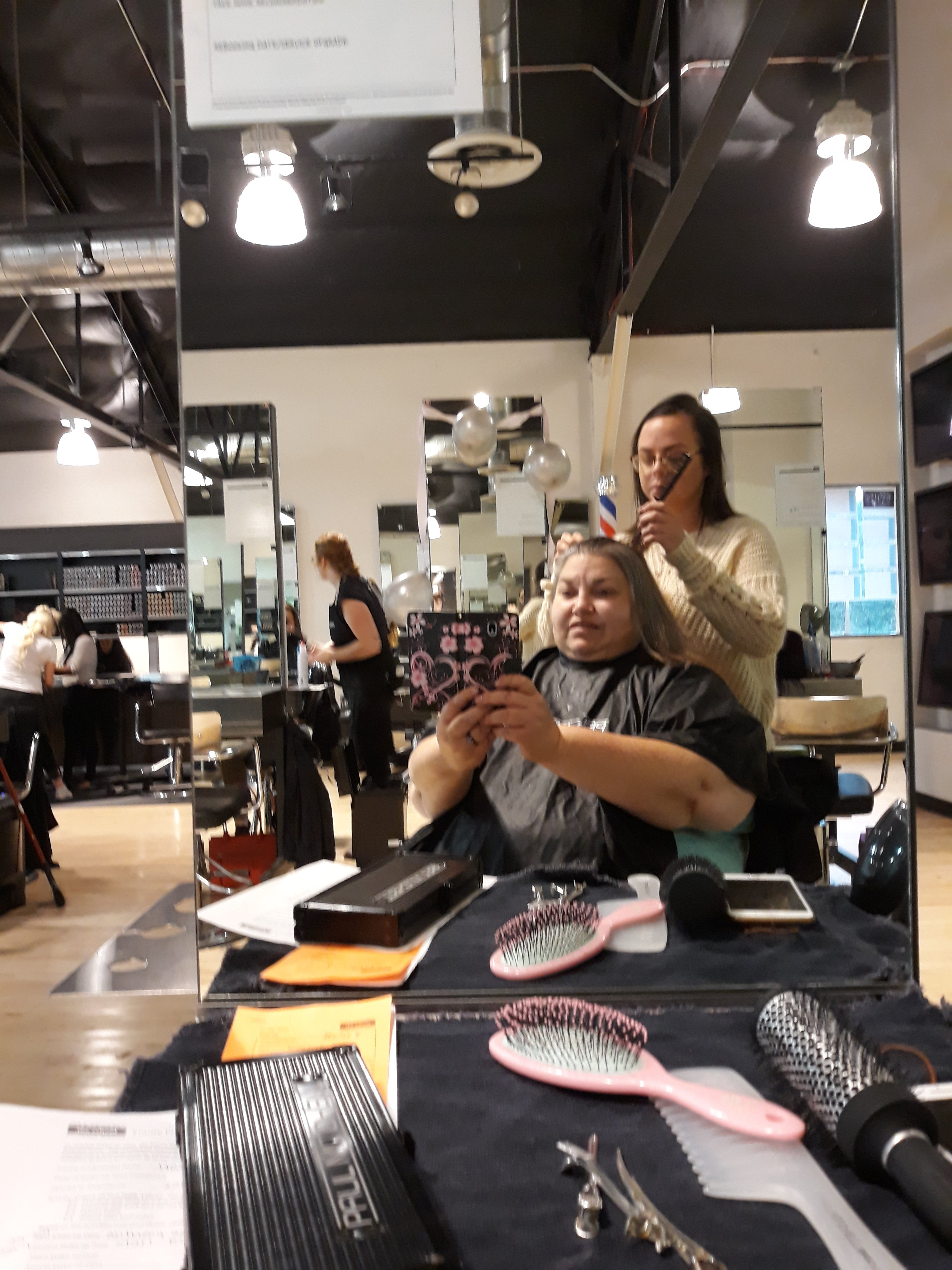 Kimberlee Plezia getting her hair cut and colored at Paul Mitchell Studios in Colorado Springs, CO