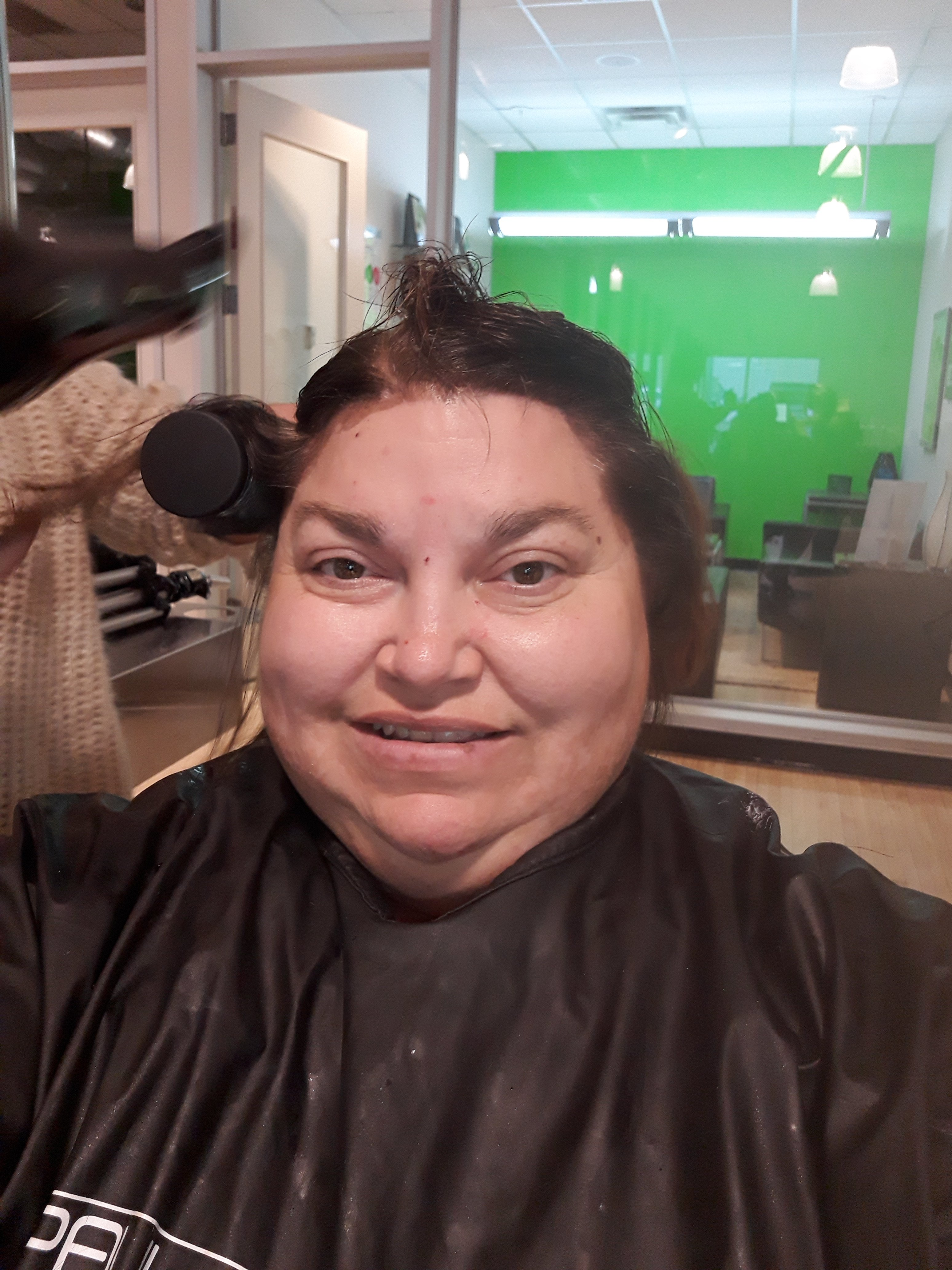 Kimberlee Plezia having her hair done at Paul Mitchell Studios in Colorado Springs, CO