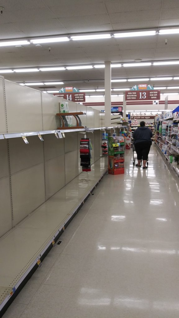 Empty grocery store shelves photo credit John Plezia
